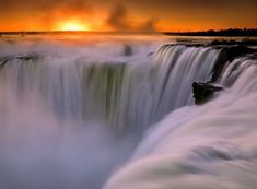 The humbling power of Iguazu falls- a true masterpiece of nature! This is La Garganta del Diablo (the Devil's throat) from the Argentine side of the falls at sunrise. Iguazu Waterfalls, Famous Waterfalls, Thunder And Lighting, Waterfall Trail, Visit Argentina, Iguazu Falls, Seven Wonders, Travel Abroad, Natural World