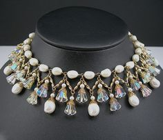 This signed Vendome bib choker necklace is simply stunning! It is drippy, with dangling ab crystals and faux pearls, held together with