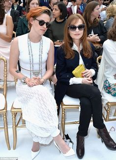 Front row: Kristen took her seat next to Isabelle Huppert at the show...