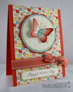 handmade Mother's Day card ... luv the pretty flower print paper combined with red base card and ribbon ... warm feeling ... die cut butterfly as focal point ...