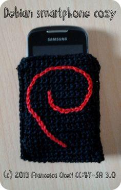 Crocheted smartphone cozy with Debian swirl