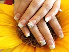Acrylic nails with French gel polish and Swarovski crystals on tip of ring finger  Nail Art