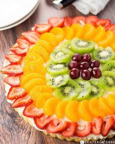 TOP-10 FRUIT PIZZA RECIPES This fruit pizza with cream cheese frosting is so easy to make, gorgeous and super yummy. Fresh berries, kiwi, peaches on a giant frosted cookie. YUM!~ This'sforyou