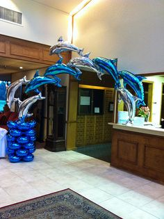 Dolphin arch foil dolphins create this enchanting arch for an under the sea theme event~long lasting decor. Ballon Arch, Deco Ballon, Balloon Columns, Dolphin Birthday Parties, Dolphin Party, Under The Sea Decorations, Balloon Decorations, Under The Sea Theme, Under The Sea Party