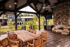 RUSTIC HOME: This boathouse has an open air pavilion, great for entertaining, with water-resistant furniture and a large stone fireplace to warm chilly evenings.