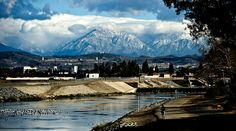 Signs of Spring: A jogger on the Santa Ana River Trail takes advantage of a beautiful day with a view of the San Gabriel Mountains (still covered with snow) from the Lincoln Avenue bridge over the Santa Ana River in Anaheim, Calif. Azusa Canyon, Orange County Beaches, Strange Weather, San Gabriel Mountains, Panoramic Photography, River Trail, Spring Sign, California Dreamin', Sierra Nevada
