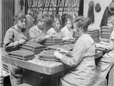 Women workers place bullets into trays in Cartridge Factory 5 at the Royal Arsenal, Woolwich.
