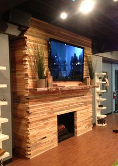 Faux fireplace made of scrap 2X4a stacked and covering a basic 2X4 inner structure. A great look with lots of character!