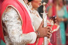 Indian wedding details. Groom's sword. Wedding photography by JSK Photography