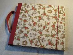 """IONA BINDING - Handmade album that measures 10,2"""" x 8,8"""". Covered with Japanese fabric."""