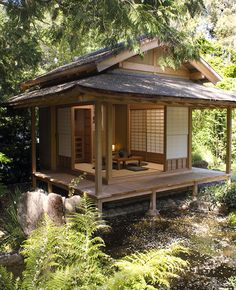 This garden complex, constructed for a private residence in San Rafael, CA, includes a traditional Japanese tea house, an entrance gate, a sheltered bench, and a wooden bridge.