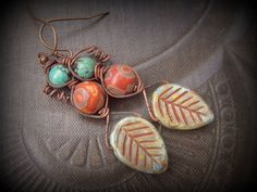 Hey, I found this really awesome Etsy listing at https://www.etsy.com/listing/212327602/glass-leaf-dzi-agate-turquoise-wire
