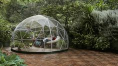 Garden Igloo - Stylish Conservatory, Play Area for Children, Greenhouse or Gazebo. The Garden Igloo is a transparent canopy for your garden that allows you to cherish the scenery all while being shielded under a geodesic dome.