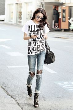 Dramatise your street-wear with a bold graphic tee. Add lace peek-a-boo, from ripped clothing for a feminine-edgy look.