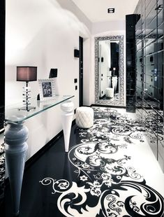 Beautiful black and white lobby with unique graphic tiles on floor.