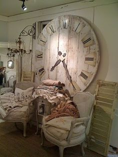 I want. Wonder how hard it would be to make this clock? Hmmm...glue up boards...use pencil and string for compass to make circle...paint..distress, stencil on roman numerals....clock kit and ta daaaaaaa