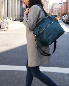 MZ Wallace Bedford Nylon Chelsea Bag, showing crossbody strap, worn while walking on Crosby Street, Soho, New York City.