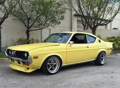 This 1974 Mazda RX-4 sports a tough, old school street racer look, with front and rear spoilers and an excellent set of SSR Longchamp wheels. Mods aren't limited to the exterior, and other details include a wild, bridgeported, Holley carb topped 13B, four wheel discs, an RX-7 sourced limited sl