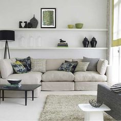 shelving behind couch great for displaying photos and other treasures!!