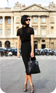 Parisian chic....hair style is wonderful.