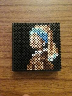 Mini Girl with a Pearl Earring by HDorsettcase Strijkkralen Perler Bead Templates, Diy Perler Beads, Pearler Bead Patterns, Perler Patterns, Loom Patterns, Art Patterns, Mosaic Patterns, Painting Patterns, Crochet Patterns