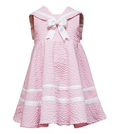 I adore sailor dresses for little girls.  White bobby sox and patent leather shoes...