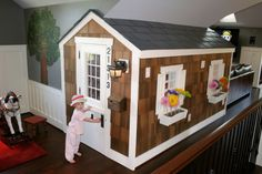 This was done in an attic but great ideas for the basement or lower bunkhouse; note seating area, game table, pool table, little playhouse with shingles, siding, etc. - so cute for the kids....  our humble abode: February 2010