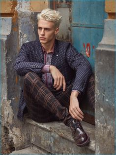 Stealing a quiet moment, Oliver Stummvoll models a Massimo Rebecchi jacket with a Bottega Veneta shirt, Vivienne Westwood trousers, and Giorgio Armani shoes.
