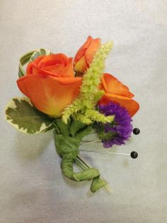 Orange rose boutonniere with purple statice and lime amaranthus accents. Boutonniere by Seasonal Celebrations. http://www.seasonalcelebrations.com