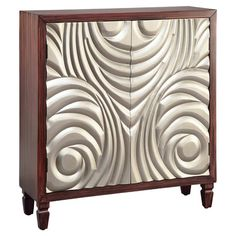 Dark cherry-finished cabinet with 2 Art Deco-inspired doors.  Product: CabinetConstruction Material: Wood