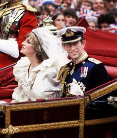 The Prince and Princess of Wales return to Buckingham Palace by carriage after their wedding, 29th July 1981. She wears a wedding dress by David and Elizabeth Emmanuel and the Spencer family tiara. (Princess Diana Archive/Getty Images)