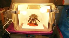 It doesn't take much to improve your pictures, Dave used spare bulbs, paper, and a tuperware for his light box http://www.40kaddict.uk/2016/10/home-made-light-box.html?showComment=1475445198197
