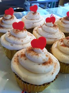 Eggnog cupcake with dusting of nutmeg and fondant heart