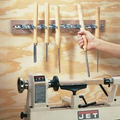 DIY Tip of the Day: Lathe Tool Storage. Are your lathe tools always getting buried in a pile of chips or rolling—point first—off the bench? Try snapping lathe-turning tools into spring-loaded broom handle clamps mounted within easy reach of the lathe. They're securely stored and easy to see and grab. This device also helps you practice the Zen of returning each tool to its clamp before selecting the next one.