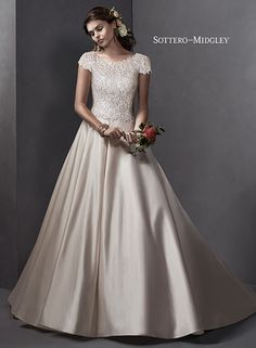 Traditional satin ballgown with full skirt, subtle scoop neckline and Swarovski crystal belt. Taiya by Sottero and Midgley.