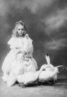 Haunting expression on this sweet little girls face. Love her pet ducks. Vintage Children Photos, Vintage Girls, Vintage Pictures, Old Pictures, Vintage Images, Old Photos, Vintage Dog, Antique Photos, Vintage Photographs