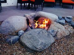Using glacial granite stones to frame the fire pit lends a rough beauty to your yard.
