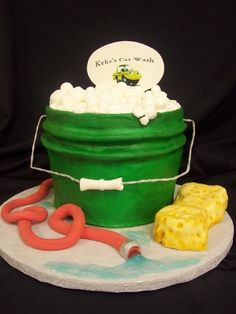 Car wash bucket cake created by: Cakes by Mom and Me, LLC