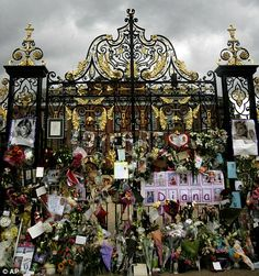 Mourned: The gates of Kensington Palace adorned with tributes in 1997