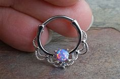 16 gauge purple opal daith hoop ring, daith clicker, or septum hoop. A purple opal centered around a lacey hoop is made of surgical steel set with the purple opal being Can also be u Innenohr Piercing, Daith Piercing Jewelry, Daith Earrings, Cool Piercings, Septum Piercings, Smiley Piercing, Septum Ring, Piercings Bonitos, Tatuajes Tattoos