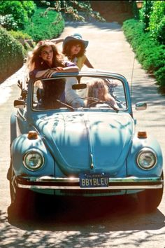 Girls want to have fun ... on a Celeste VW Bug