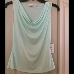 Mint color Calvin Kein Blouse - Brand New! Size XS Lovely Mint Color Calvin Klein Blouse! Perfect for work suits or to wear by itself - Never been worn tags on still on! Details: 95% Polyester 5% Spandex Calvin Klein Tops Blouses