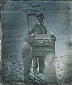 Organ Grinder on Street with Children Passing, ca 1848  I love the ghostly effect made by the moving children.