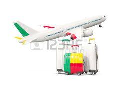Luggage with flag of Benin. Tres maletas frente a un avión