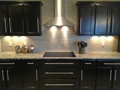 Electric cooktop & range hood with beautiful dark cabinets and backsplash