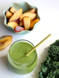 Peachy Pineapple Kale Smoothie with coconut water to replenish electrolytes -- ideal post-workout recovery drink (or anytime, really!)