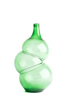 """Design by Klaas Kuiken. """"How simple mass-produced bottles of green glass can become unique objects? Klaas Kuiken was intrigued by the question whether mass-produced items can show some kind of irregularities. It appeared to be the case with these bottles and Klaas turned their 'flaws' into something beautiful, re-forming them by using his own technique of glass-blowing."""""""
