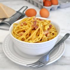 Classic Italian Spaghetti alla Carbonara: rich and creamy sauce and sinfully crispy pancetta. You will love it!
