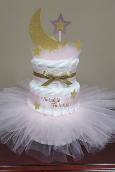 Twinkle twinkle little star diaper cake! Baby shower centerpiece gift. Pink and gold twinkle little star diaper cake. Visit my Facebook page Simply Showers for more pics and orders. Thanks Kim