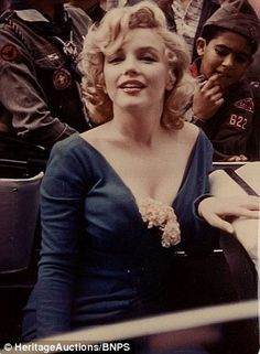 Color shot of Marilyn highlights her platinum blonde hair and peaches and cream complexion
